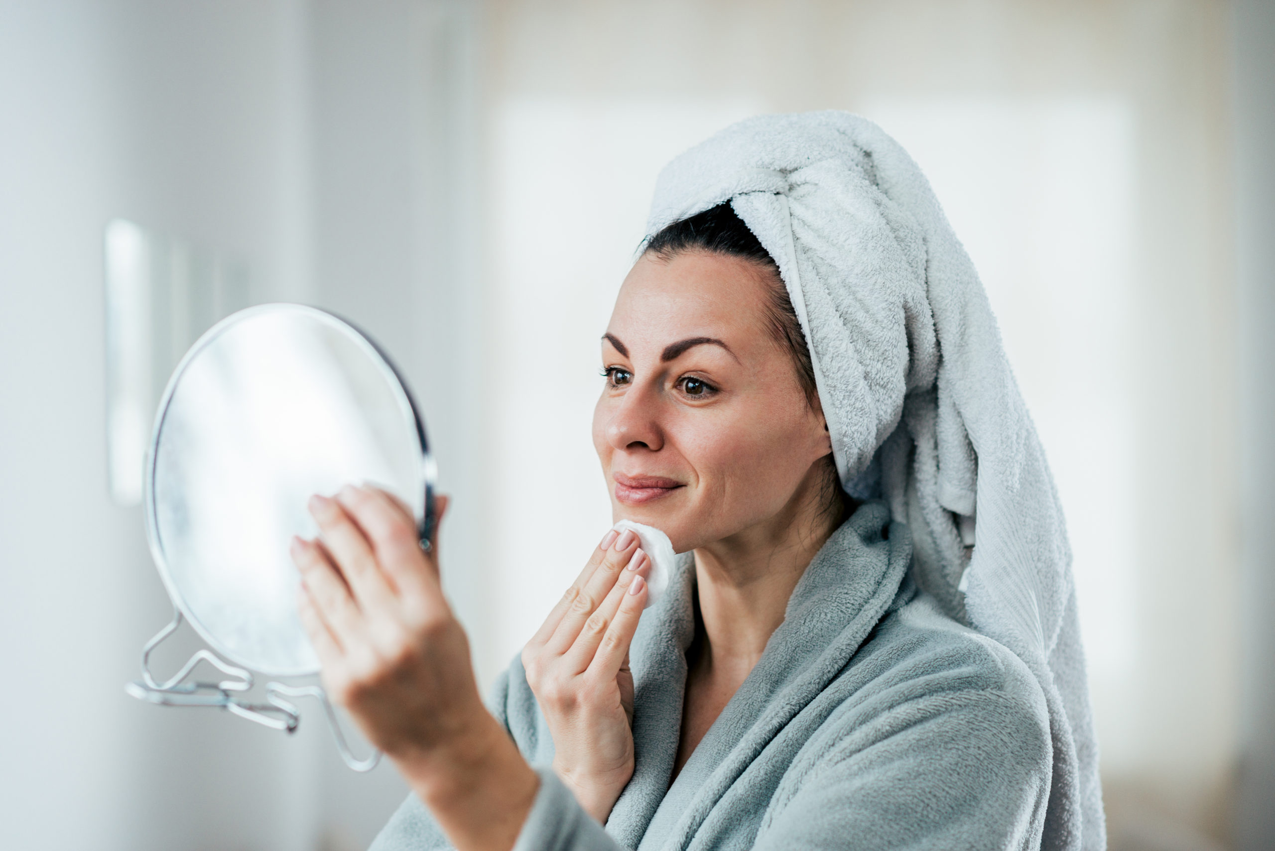 Beauty, hygiene and people concept. A picture of a woman cleaning her face.